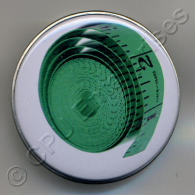 Green Tape Measure in a Tin